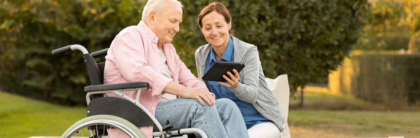 senior resident in wheelchair with caregiver