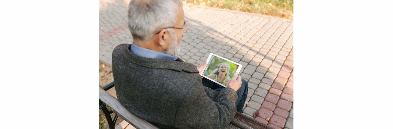 elderly man video chatting with family