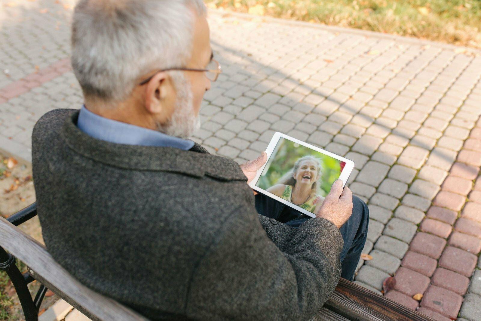 senior man watching ipad